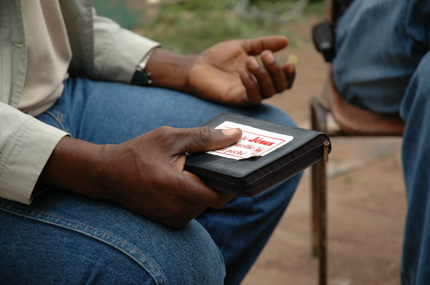 Hands teaching the Word