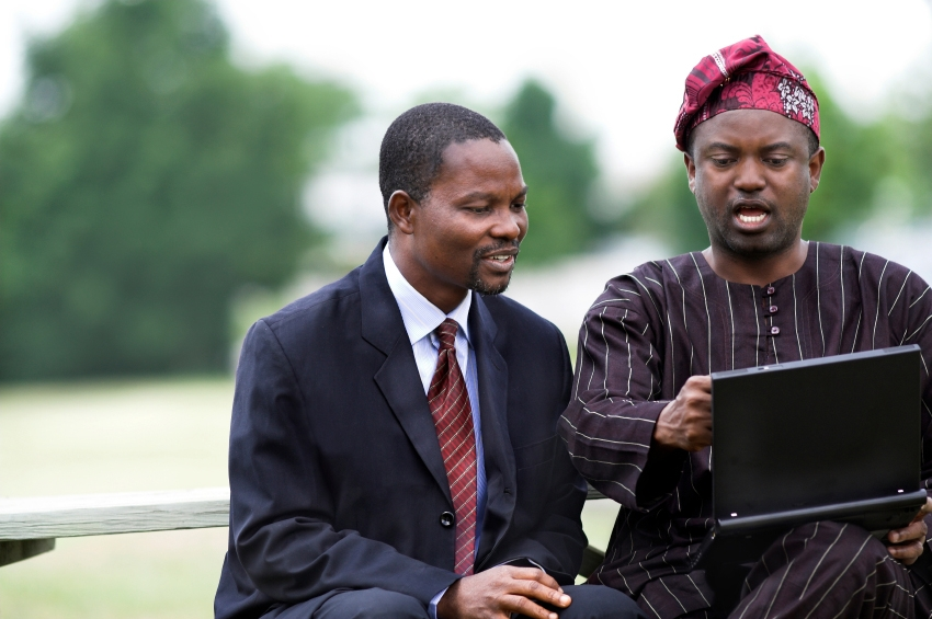 two African men studying